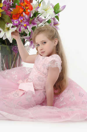 the girl in a pink  dress with a bouquet Stock Photo - 14403024