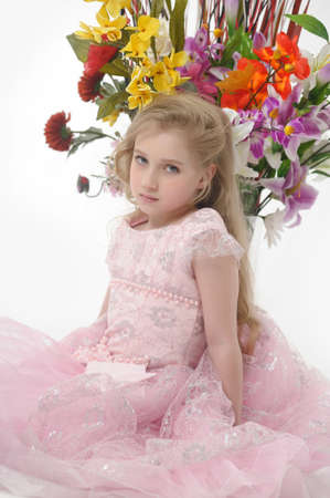 the girl in a pink  dress with a bouquet Stock Photo - 14403025