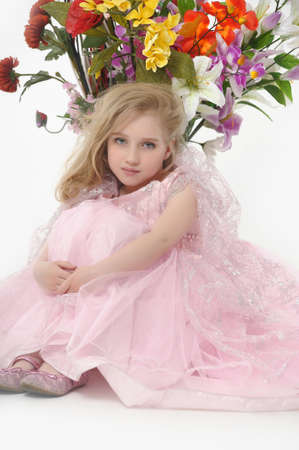 the girl in a pink  dress with a bouquet photo