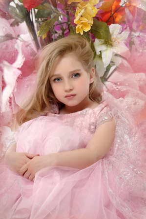 the girl in a pink  dress with a bouquet Stock Photo - 14395218