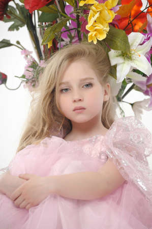 the girl in a pink  dress with a bouquet Stock Photo - 14403022