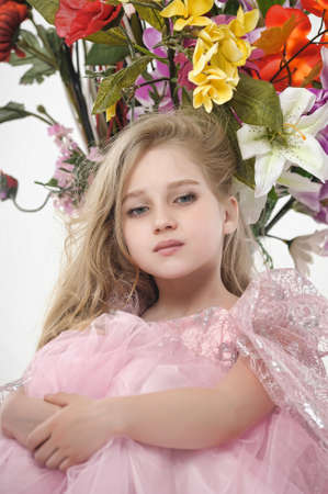 the girl in a pink  dress with a bouquet Stock Photo - 14403031