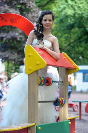 young bride on the playground Stock Photo - 15036475