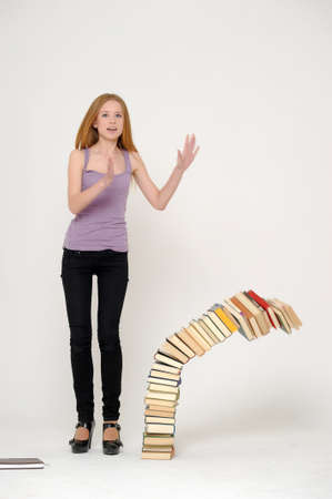 she drops a stack of books photo