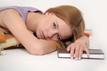 Girl sleeping with book photo