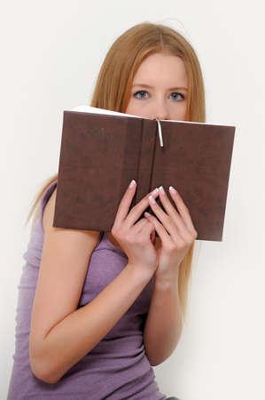 hidden danger: Look behind the book  Stock Photo