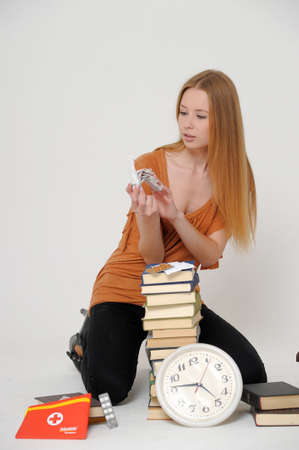 student with books and tablets in stress photo