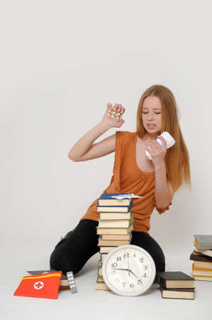 student with books and tablets in stress Stock Photo - 15391989