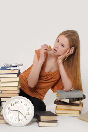 final thoughts: student with books and tablets in stress