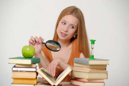 Girl student with magnifying glass  photo