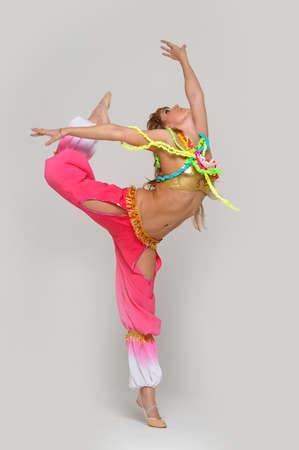 limber: Gymnast girl in flexible back pose