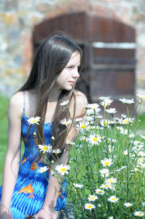 teen girl near the daisies photo