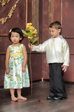 boy gives a girl flowers photo