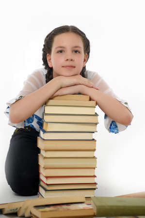 Cute young female with a stack of books photo