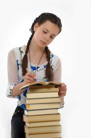 Colegio chica estudiante con los libros photo