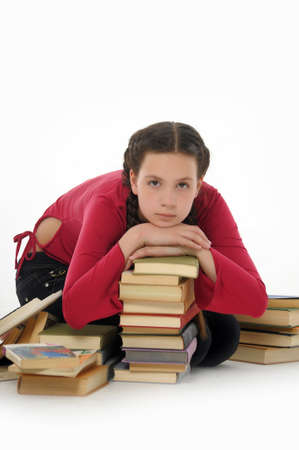 Female student leaning on stacked books photo