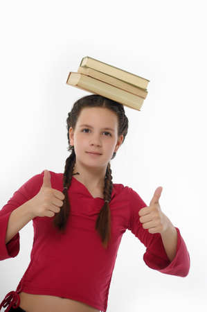 girl with Her Books on Her Head photo
