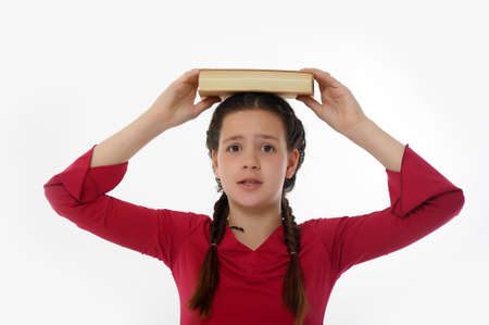 girl with Her Books on Her Head Stock Photo - 14501637