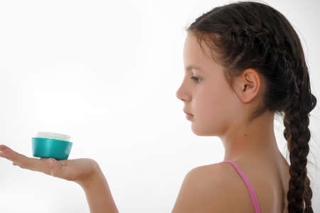 Closeup portrait of girl with cream photo