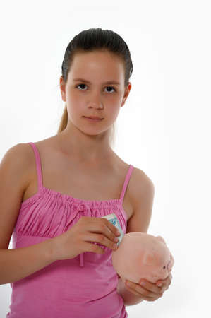 girl Holding Piggy Bank photo
