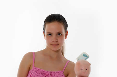 Smiling girl Holding Piggy Bank photo