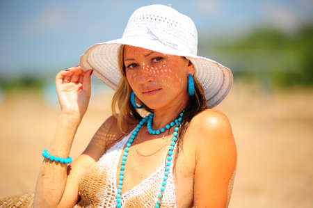 girl on the beach in a white dress and hat Stock Photo - 17084925