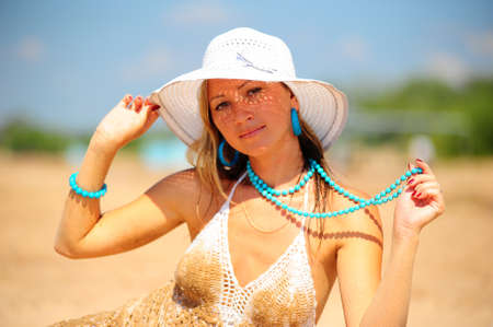 girl on the beach in a white dress and hat Stock Photo - 17084922