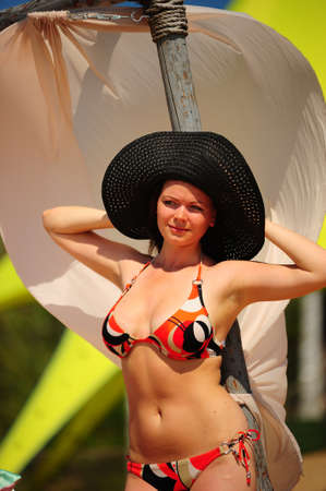 girl in a bathing suit and hat photo