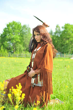 squaw: The girl in a suit of the American Indian  Stock Photo