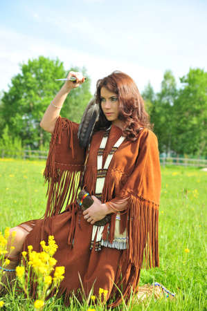 powow: The girl in a suit of the American Indian  Stock Photo
