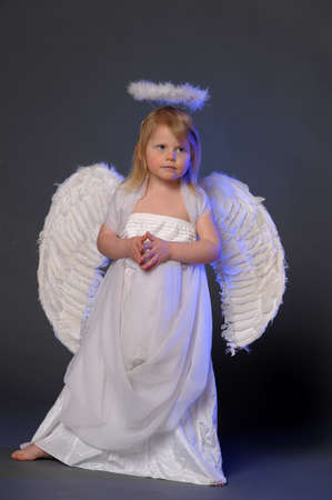 Baby girl in an angel dress photo