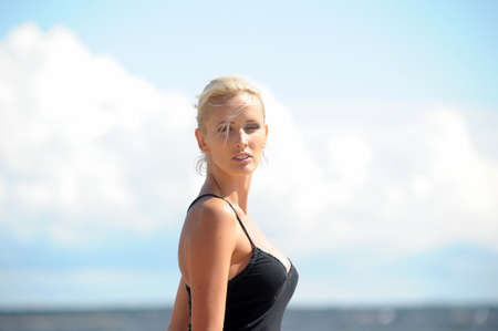 Young beautiful sexy tanned happy woman  photo