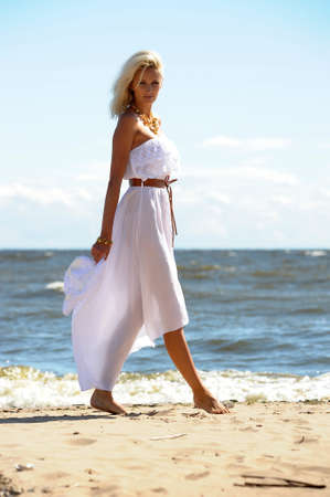 Girl in white dress on beach Stock Photo - 14552249