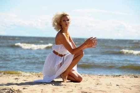 bathing women: Girl in white dress on beach