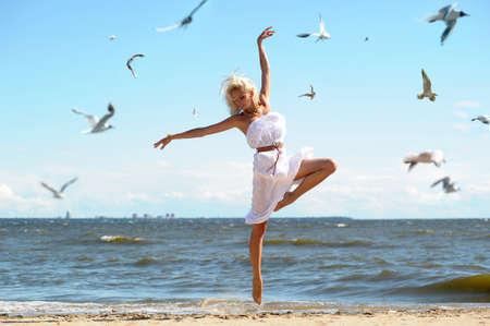 Girl in white dress on beach Stock Photo - 14552284