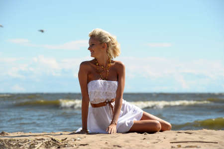 Young woman on the beach in summer photo