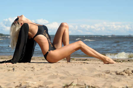 Sexy tanned woman on beach Stock Photo - 14577568