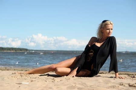 Sexy tanned woman on beach photo