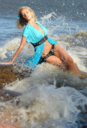 girl in a blue tunic in water photo