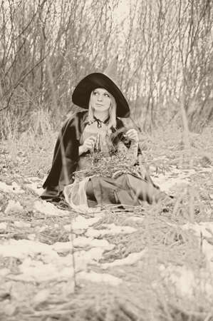 witch in the woods, stylized antique, sepia photo