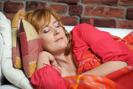 The woman has a rest in the afternoon on a sofa photo