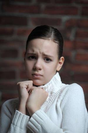 wanhopig: Portret van trieste jong meisje Stockfoto