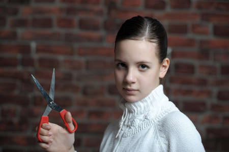 girl with scissors in hand photo