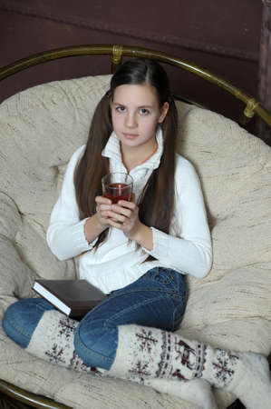 teen girl in a chair with tea photo