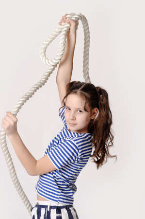 Little girl with a rope photo