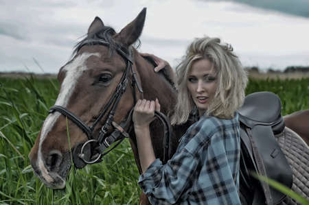 cute young farm girl: Girl with a horse