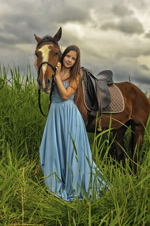 Beautiful girl  with horse on nature photo