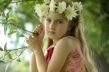 little girl in a wreath of white flowers Stock Photo - 14956049