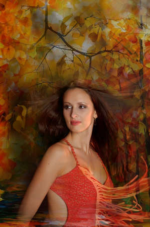 Autumn portrait of a beautiful young woman photo