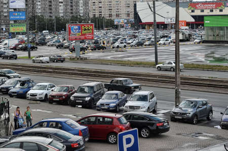 crowded space: parking in front of the hypermarket, Russia, St. Petersburg Editorial